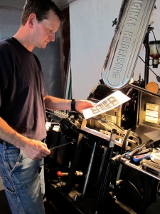 Terry checking one of Hans' first big jobs, Big Truck labels for Olympia Coffee Roasting Co.