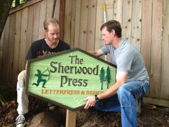 Our gorgeous new sign made by Ira Coyne (left) with installation help by Terry.