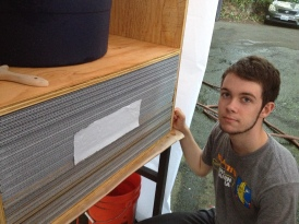 My son Parker and the paper drying box pulling air through corrugated sheets.